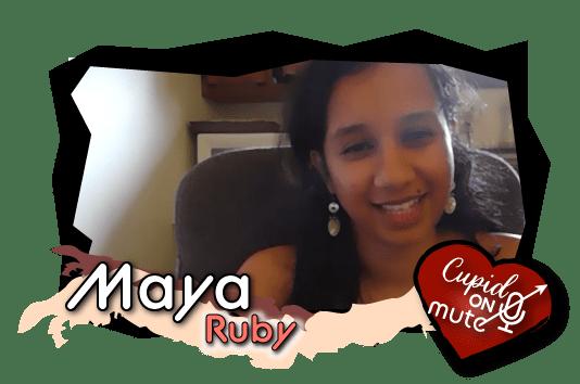 Maya, with long dark hair, grins happily into camera.